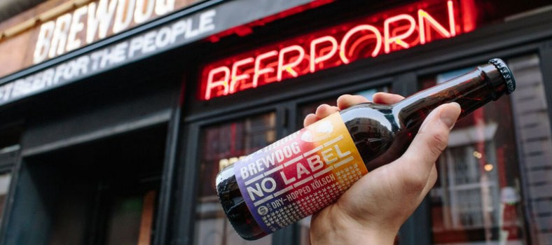 "A hand holds up Brewdog's ""No Label"" beer"