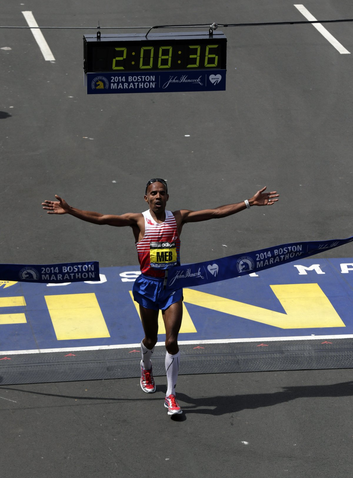 Meb Keflezighi crossing the finish line