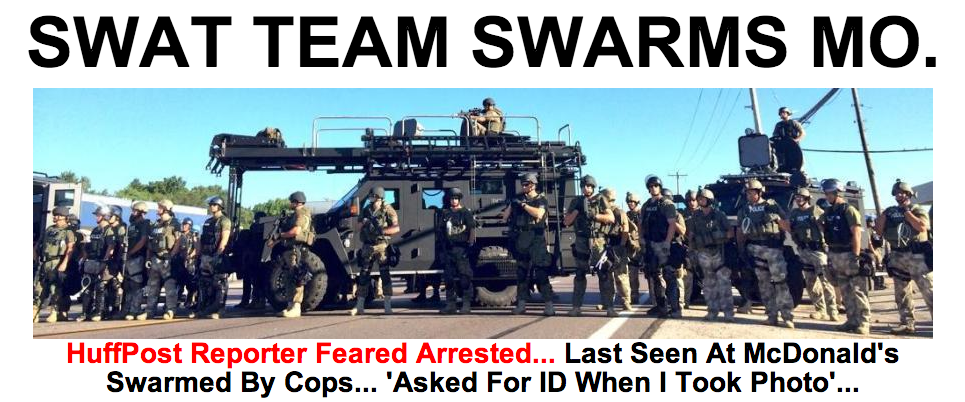 Photo of militarized police In Ferguson from the Huffington Post. Taken by a reporter who was arrested, then released.